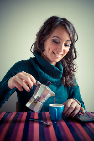 beautiful woman having breakfast at home photo