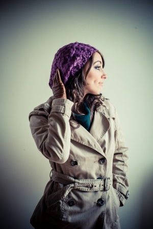 beautiful woman with turtleneck, scarf and cap autumn on white  Stock Photo