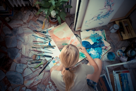 beautiful blonde woman painter in her studio photo