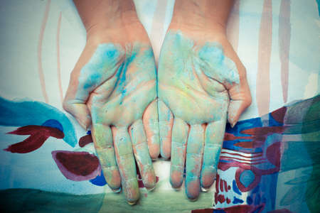 colorful painted hands on colored  photo