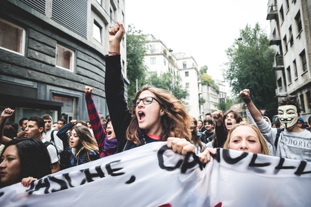 MILAN, ITALY - OCTOBER 4: Students manifestation on October, 4 2013. Students took to the streets to protest against italian austerity claiming their future
