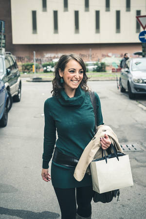 beautiful woman with turtleneck walking in the city autumn photo