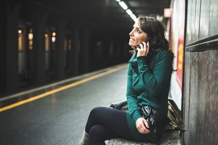 beautiful woman with turtleneck on underground in autumn photo