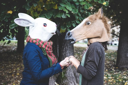 red head: horse and rabbit mask women in the park autumn Stock Photo
