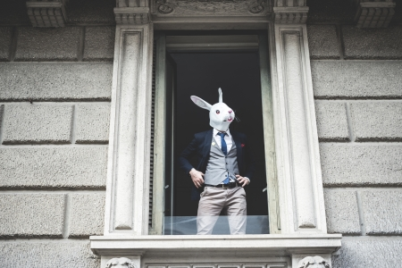 appeared: rabbit mask man appeared at the window in the city Stock Photo