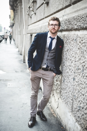 elegant attractive fashion hipster man lifestyle in the city Stock Photo