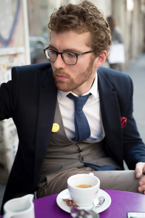 elegant attractive fashion hipster man lifestyle at the bar photo