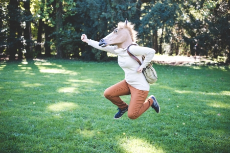young hipster horse mask woman in the woodland autumn photo