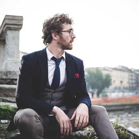 elegant attractive fashion hipster man lifestyle in the city photo