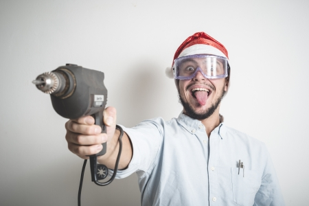driller: bricolage christmas stylish young man on white background Stock Photo