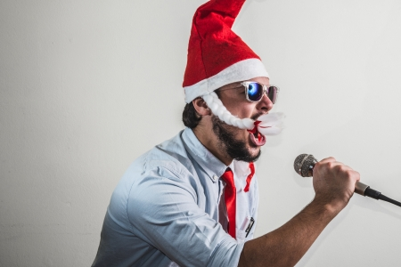 funny christmas business man singing on white background