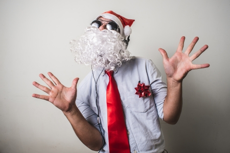 funny santa claus babbo natale listening music on white background photo