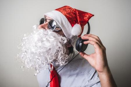 babbo natale: funny santa claus babbo natale listening music on white background