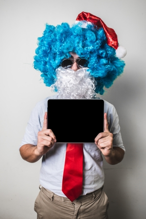 babbo natale: funny santa claus babbo natale using tablet on white background