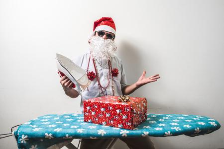 funny santa claus babbo natale ironing on white background