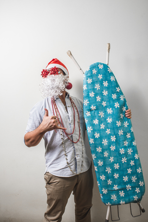 babbo natale: funny santa claus babbo natale ironing surfer on white background