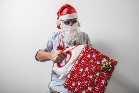 babbo natale: funny santa claus babbo natale ironing on white background