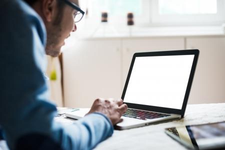 handheld computer: elegant business multitasking multimedia man using devices at home