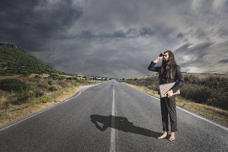 Stylish elegant dreadlocks businessman binoculars in road landscape Stock Photo - 24139975