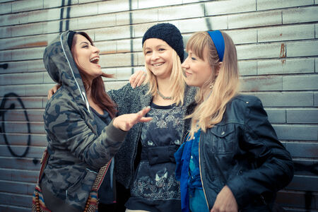 three friends woman in urban contest photo