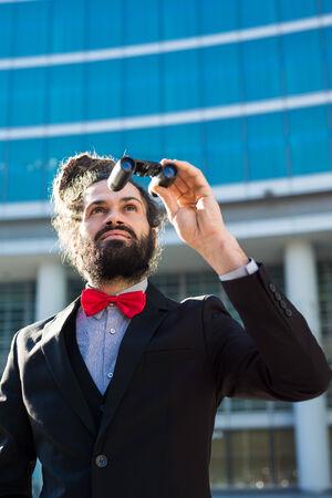 Stylish elegant dreadlocks businessman binoculars in business landscape Stock Photo - 24425345