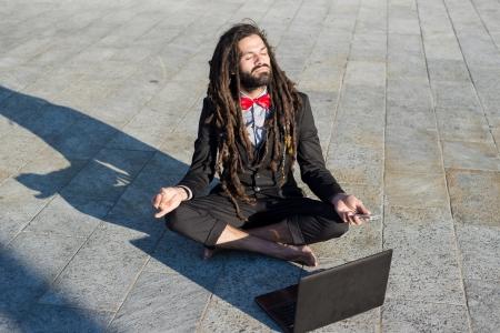 rasta: Stylish elegant dreadlocks businessman using notebook in business landscape
