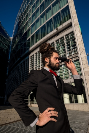 Stylish elegant dreadlocks businessman binoculars in business landscape Stock Photo - 24333343