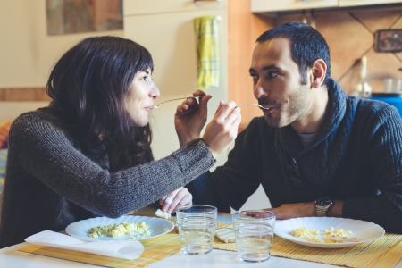 couple in love eatingin lunch at home photo