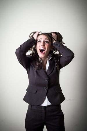 frustrated beautiful young businesswoman on gray background photo