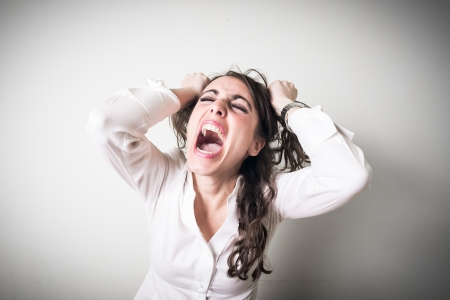 frustrated beautiful young businesswoman on gray background Stock Photo