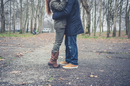 close up of legs couple in love at the park winter photo