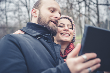 smiing: couple in love selfie at the park winter