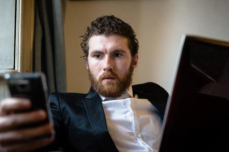 handsome bearded hipster elegant man using laptop