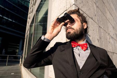 Stylish elegant dreadlocks businessman binoculars in business landscape Stock Photo - 25629469