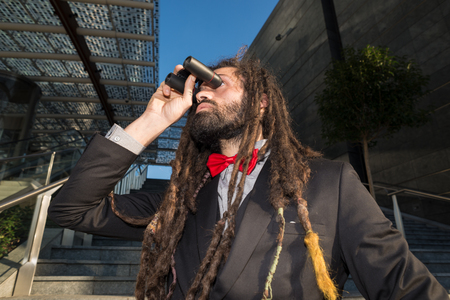 Stylish elegant dreadlocks businessman binoculars in business landscape Stock Photo - 25636284