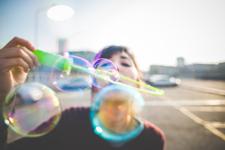 young beautiful hipster woman bubble blower in the city Stockfoto