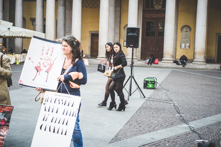abuses: MILAN, ITALY - MARCH 21: 269 Life protest on March 21, 2014. People shocked looking at 269 activists performance  against animal abuses and pro vegan lifestyle