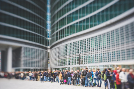 ambiente: MILAN, ITALY - MARCH 23: People visitng Palazzo Lombardia, most high and important building in Milan,  opening for visitors during FAI, Fondo Ambiente Italiano, on MARCH 23, 2014 in Milan.