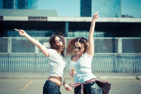 dancing girl: two beautiful young women dancing in the city