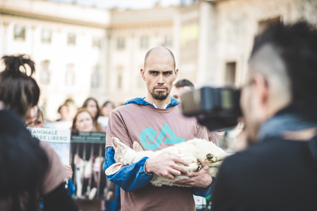 MILAN, ITALY - APRIL 13: Essere Animali protest on April, 13 2014: a group of activists of animal rights association Essere Animali performed with real dead lambs in city center before easter Editorial