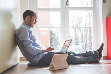 elegant business multitasking multimedia man using devices at home photo