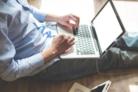 elegant business multitasking multimedia man using devices at home photo