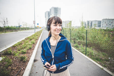 desolate: beautiful woman listening music in a desolate lurban landscape Stock Photo