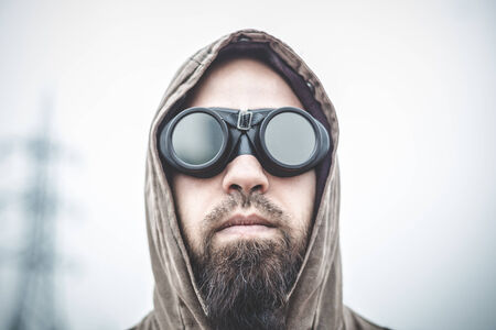 man with aviator glasses in a desolate landscape Stock Photo - 28199823