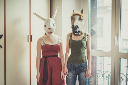 lesbian couple: mask rabbit and horse mask lesbian couple at home