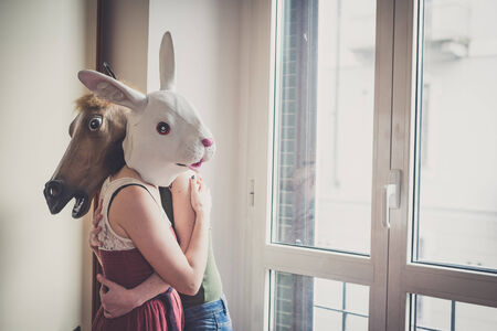 mask rabbit and horse mask lesbian couple at home photo