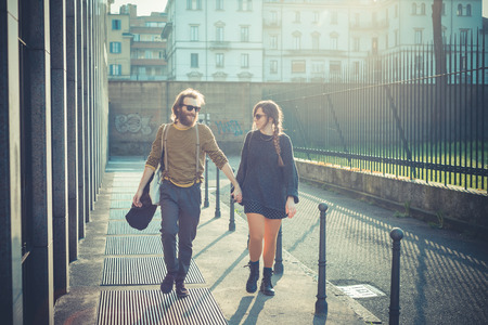 young modern stylish couple urban city outdoors photo