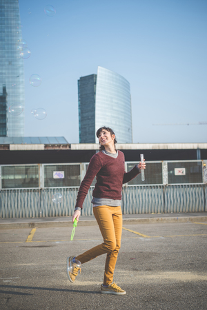 young beautiful hipster woman bubble blower in the city photo