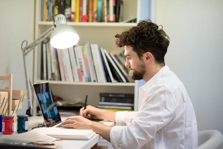 illustrator: handsome hipster modern man designer working home using laptop at home