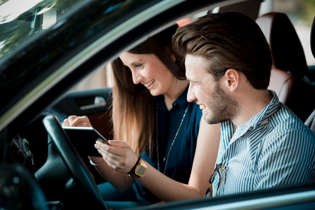 navigator: young beautiful couple lovers using tablet in the car travel Stock Photo